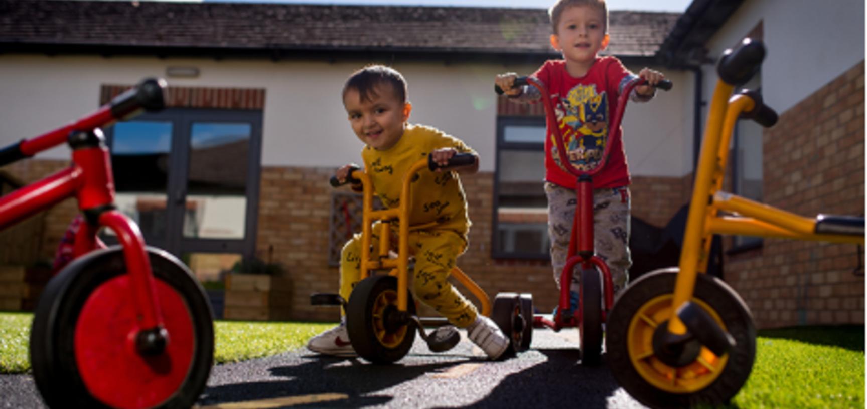 children on bikes in sunny garden